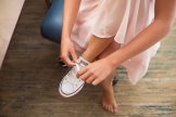 bridesmaid putting her shoes on