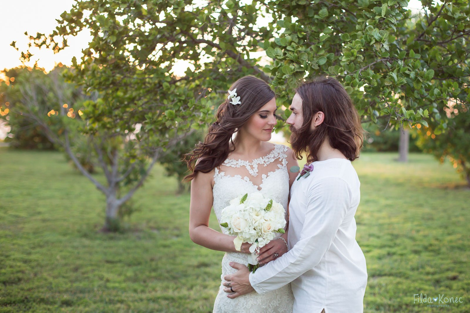 bride and groom cuddling in beautiful landscape at fort zachary taylor state park