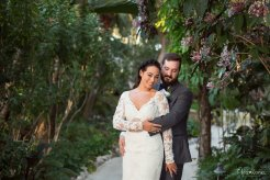 bride and groom pose for their wedding photos