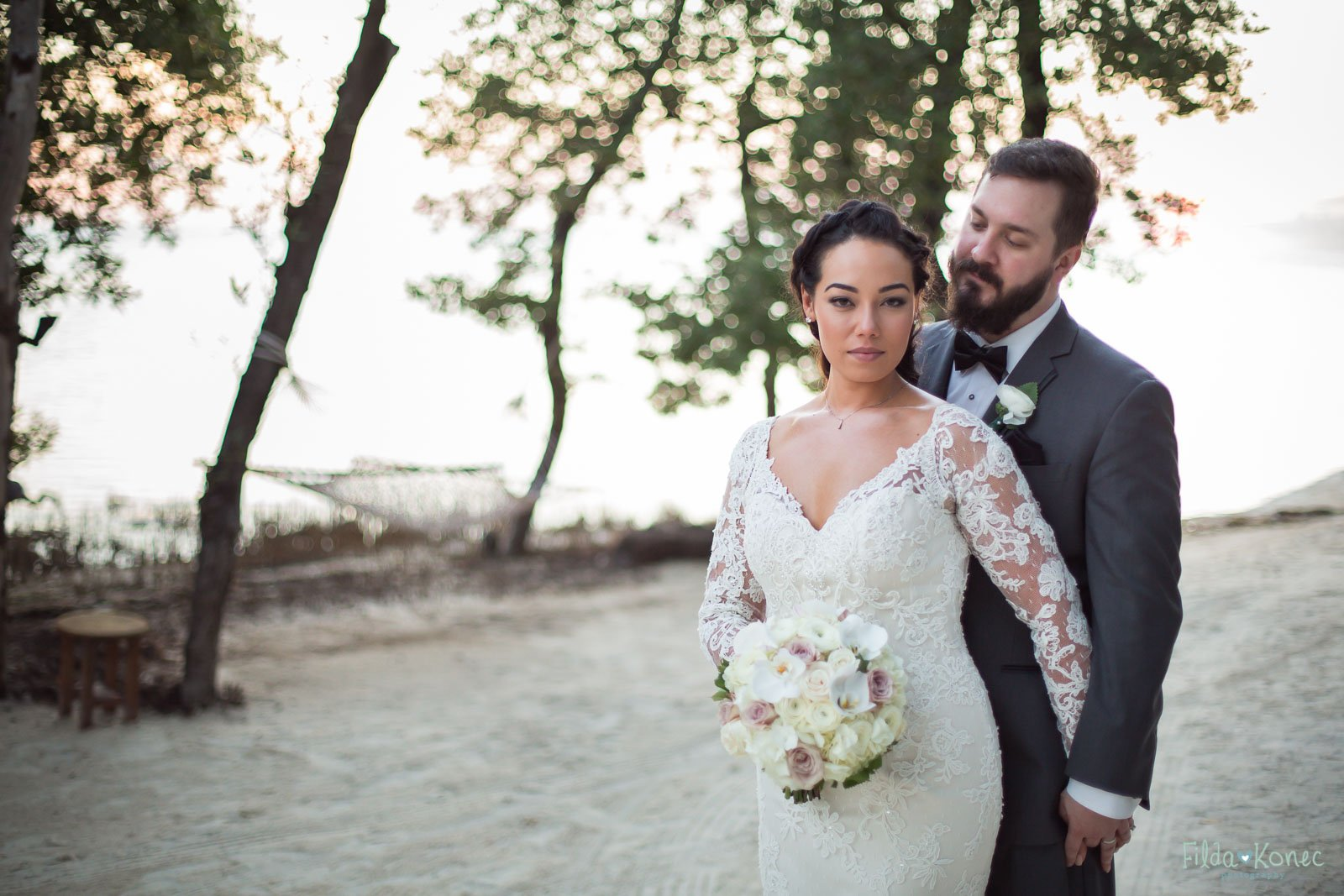 bride and groom photo during sunset