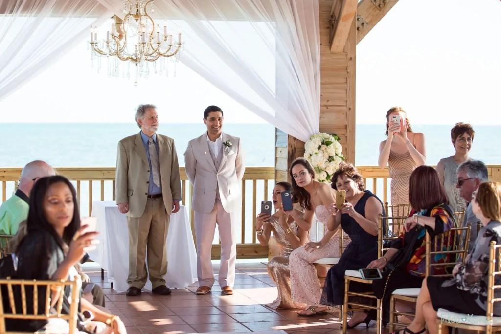 groom waiting on his bride