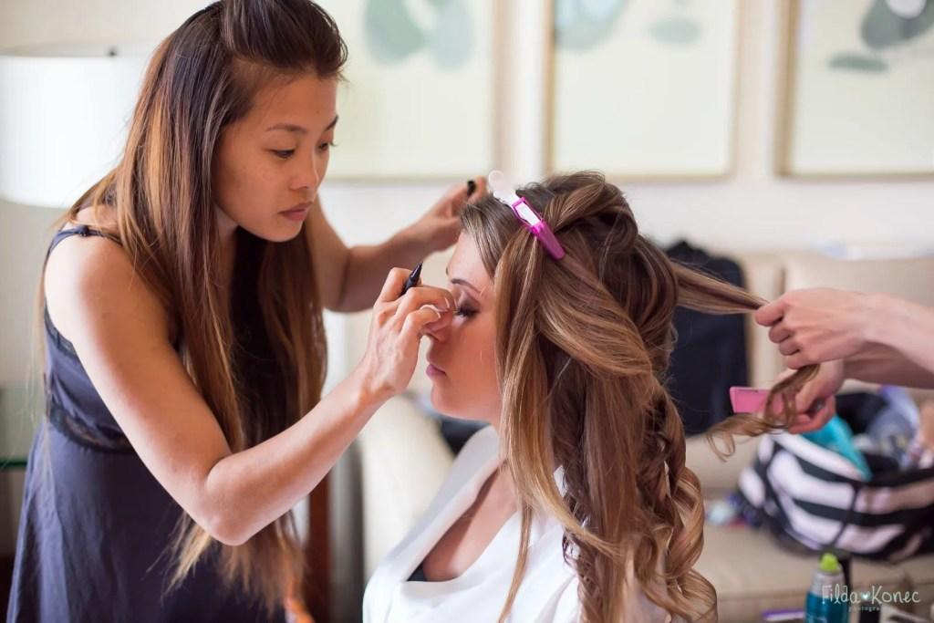 make up artist working on brides makeup