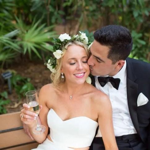 groom kissing his bride at their hemingway home wedding in key west