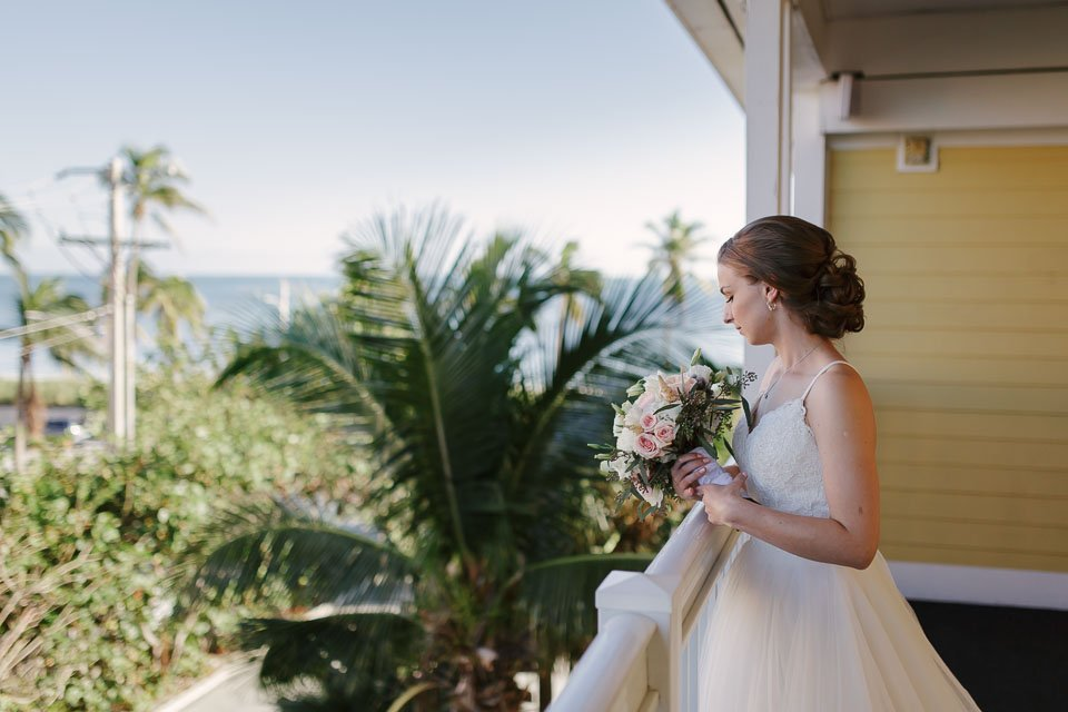 bride looking out of balcony at sheraton suites