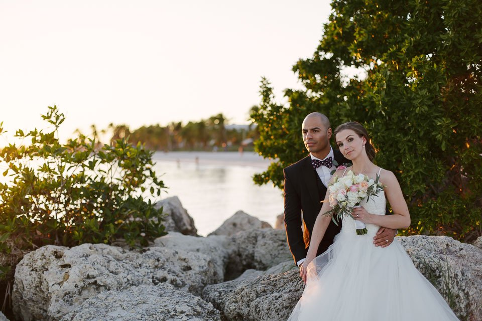 bride and groom on key west beach with ocean in the background