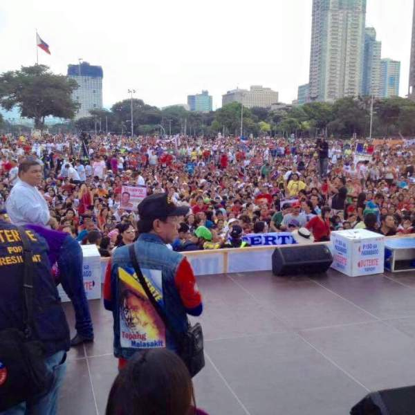 Duterte reconsiders decision not to run as president as his supporters gather at Luneta