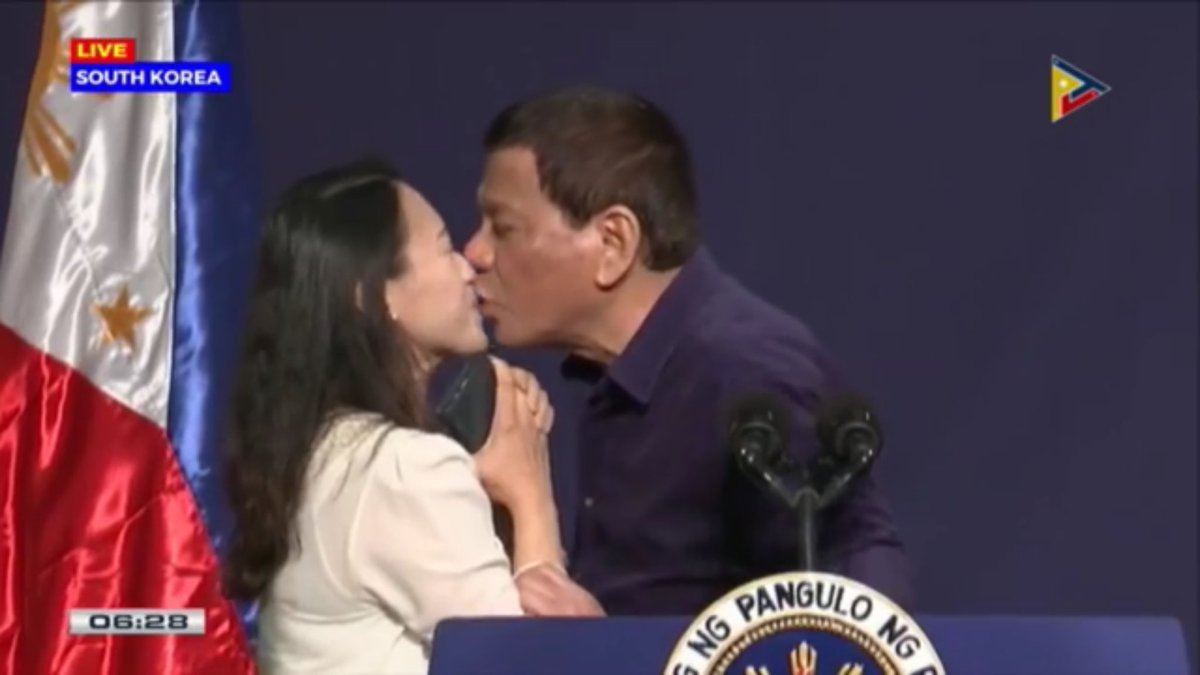 Crowd goes crazy as President Duterte lip-kisses an OFW in South Korea