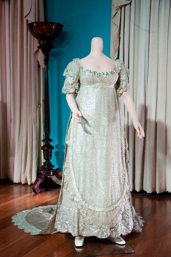 Princess Charlotte Married Prince Leopold of Saxe-Coburg in 1816.  An elaborate cloth-of-silver empire line dress embroidered with flowers and trimmed with Brussels lace.