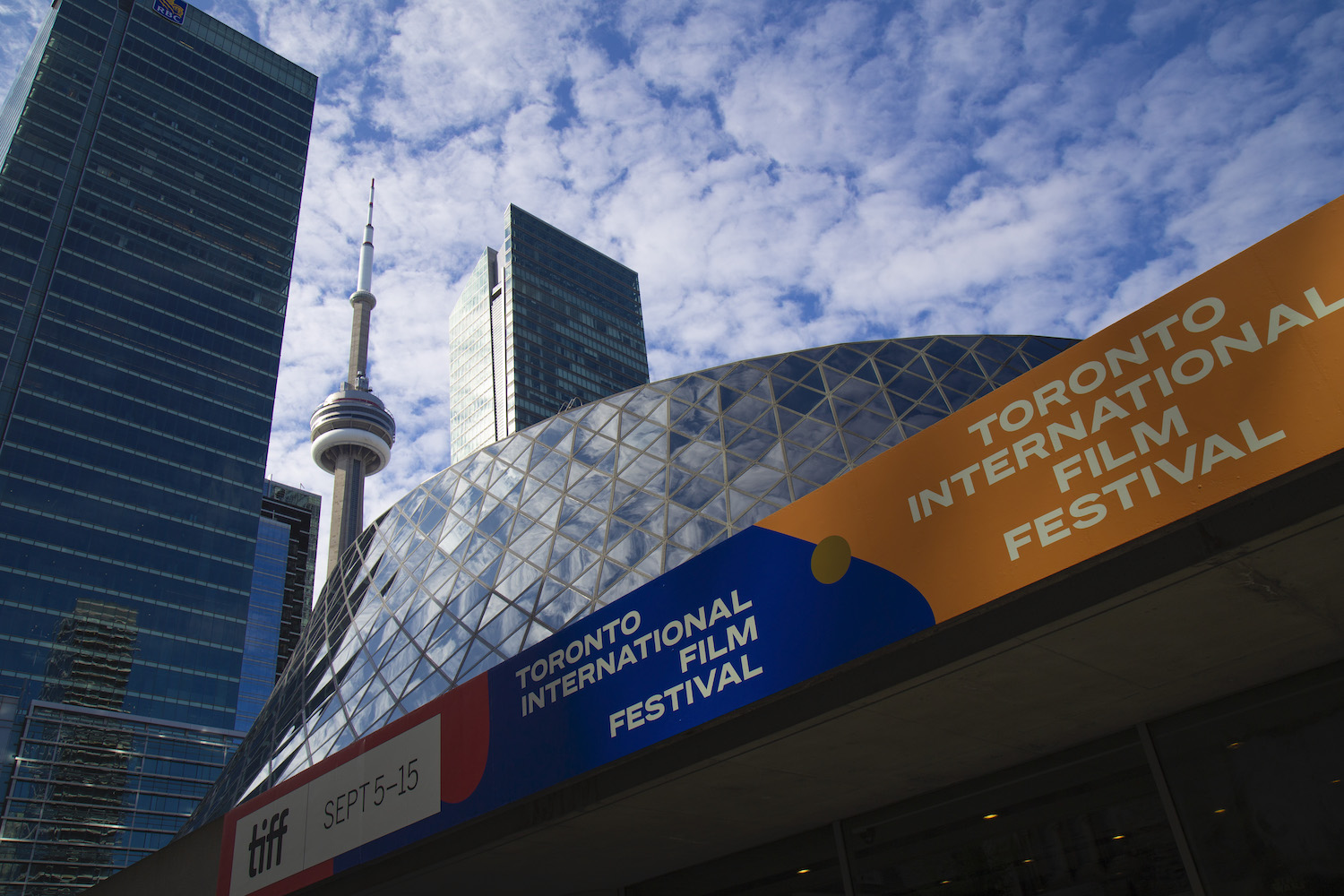 Roy Thomson Hall, with CN Tower in background, at the 2019 Toronto International Film Festival
