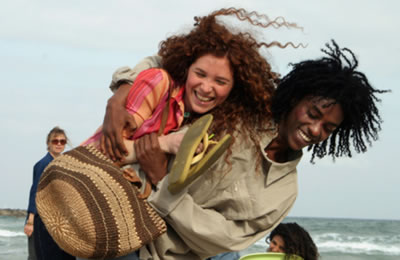Image from LIVE AND BECOME - Lovers, Shlomo (Sirak Sabahat) and Sarah (Roni Hadar) walking arm-in-arm on the beach
