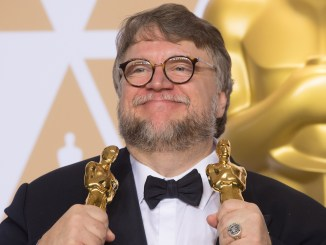 """Guillermo del Toro  pose backstage with the Oscar® for best motion picture for work on """"The Shape of Water"""" during the live ABC Telecast of The 90th Oscars® at the Dolby® Theatre in Hollywood, CA on Sunday, March 4, 2018."""