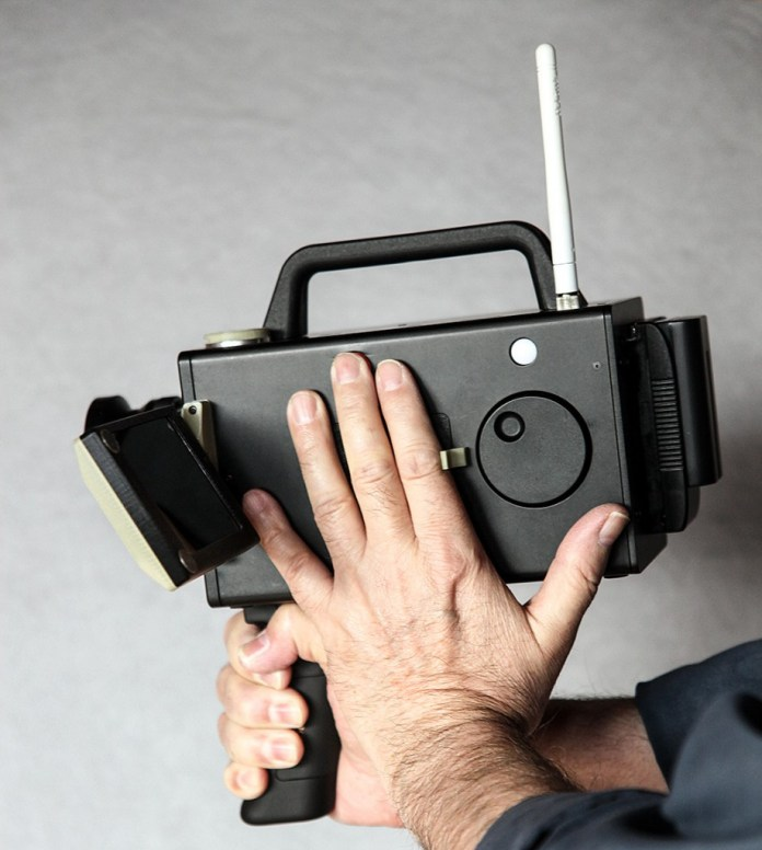 The prototype with a 10mm Cooke lens and screw-on top handle. The camera body is only slightly wider than top-of-the-range Super 8 cameras from the 1970s.