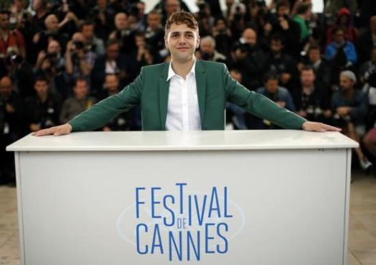 "Director Xavier Dolan poses during a photocall for the film ""Mommy"" in competition at the 67th Cannes Film Festival in Cannes"