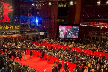 "Guests arrive for the screening of ""The Grand Budapest Hotel"" presented in the Berlinale Competition of the 64rd Berlinale Film Festival and opening ceremony in Berlin, on February 6, 2014. The 64rd Berlinale, the first major European film festival of the year, starts on February 6, 2014 with 24 international productions screening in the main showcase.     AFP PHOTO / POOL / TIM BRAKEMEIERTIM BRAKEMEIER/AFP/Getty Images"