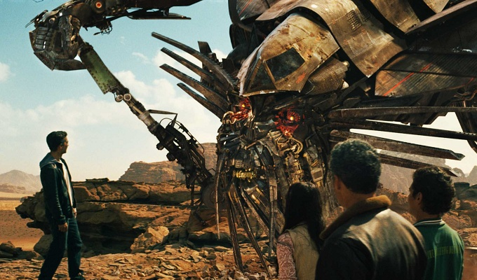 (Left to right) Sam Witwicky (Shia LaBeouf) speaks with the Autobot¨ Jetfire as his cohorts Mikaela Banes (Megan Fox), Agent Simmons (John Turturro) and Leo (Ramon Rodriguez) look on in ÒTransformers: Revenge of the FallenÓ directed by Michael Bay.