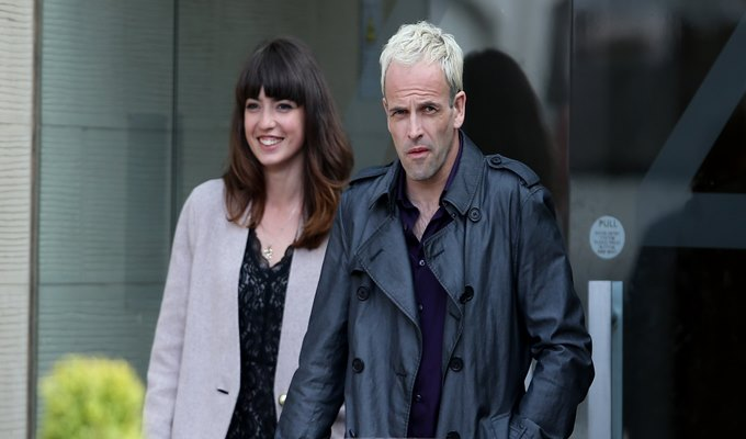 Actor Jonny Lee Miller (right) with an unknow actress during the filming of a scene from his new film Trainspotting 2 which is being filmed in Edinburgh.