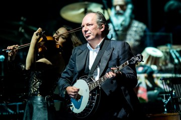 Oscar, Grammy and Golden Globe-winning German composer Hans Zimmer performs live during his concert at the Papp Laszlo Sports Arena in Budapest, Hungary, Wednesday, May 11, 2016. (Janos Marjai/MTI via AP)
