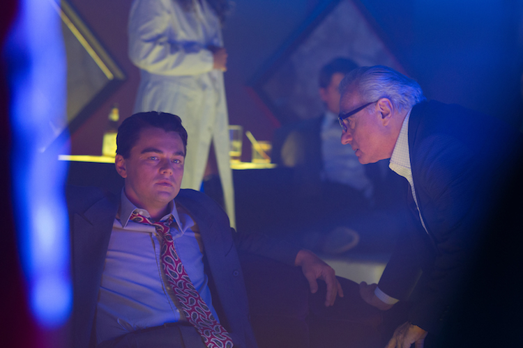 Director/Producer Martin Scorsese (right) discusses a scene with Producer Leonardo DiCaprio (as Jordan Belfort, left) on the set of THE WOLF OF WALL STREET, from Paramount Pictures and Red Granite Pictures. TWOWS-00443