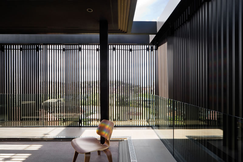 Folding Vertical Louvered Shutters On Freshwater House