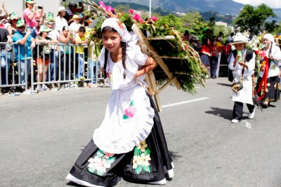 A young silletera in last year's parade with her silleta