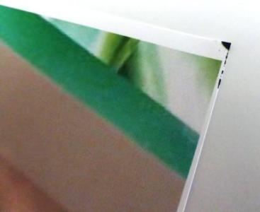 Intermittent staining on bottom corner of printed photographs and graphics.