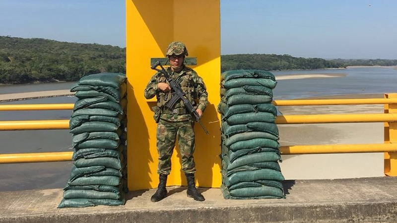 A solider safeguards a bridge in Colombia this weekend as the Army ramped up security efforts. (Credit: Ejército Nacional de Colombia)