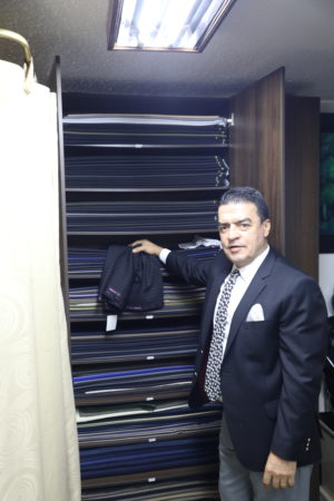 Almacen Lord does not stock suits. Everything is custom made to order for the customer. Here Don Hernando shows off many of the wools imported from Italy, Great Britain, New Zealand, and other sources.