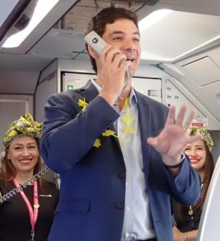 Viva Air CEO Felix Antelo welcomes passengers on the airline's inaugural flight from Medellín to Cali