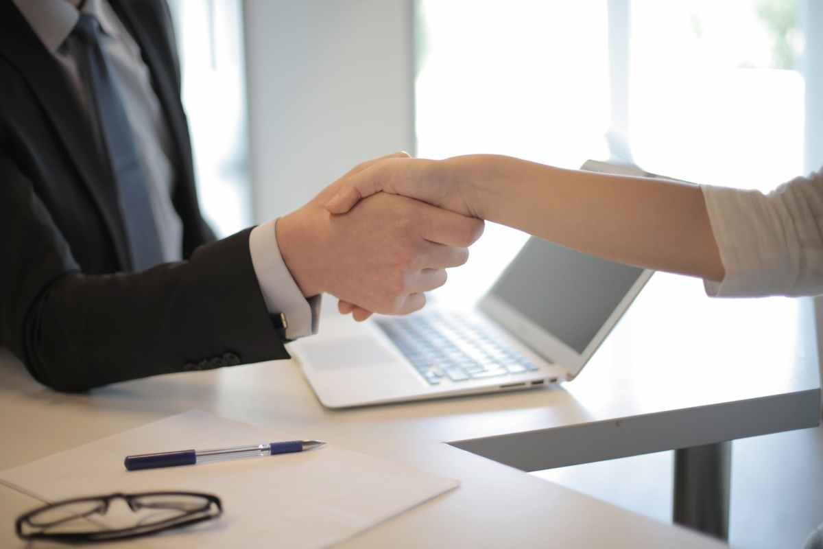 an image of two people shaking hands in agreement