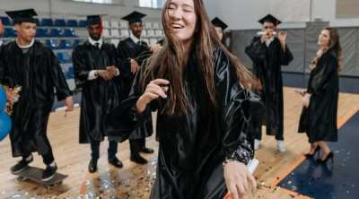 photo of woman wearing graduation gown