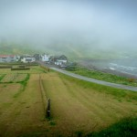 Town of Tjørnuvík in the fog near the beach.