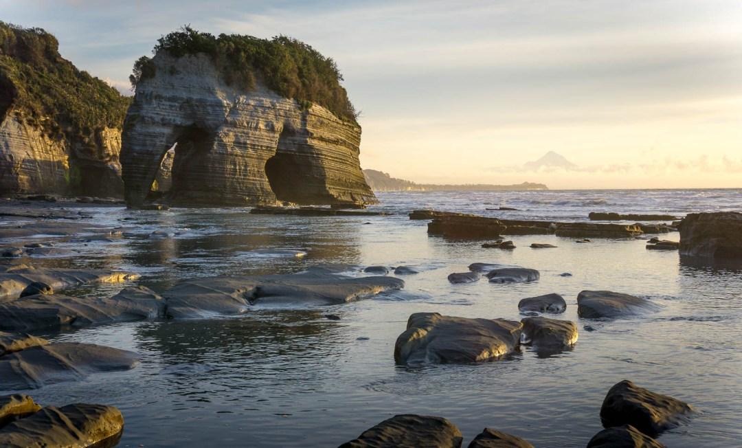 Elephant Rock at sunset in Taranaki New Zealand