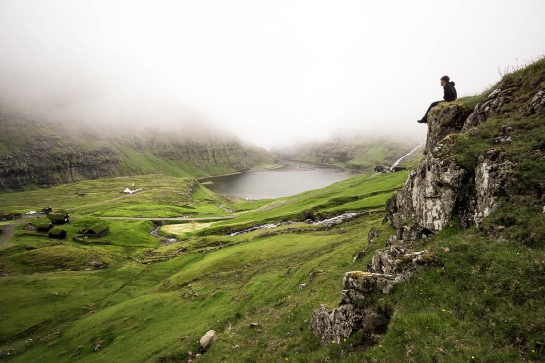Hiking above Saksun, Ben Campbell on cliff.