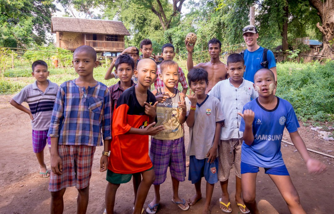 Group photo of Burmese kids playing volleyball