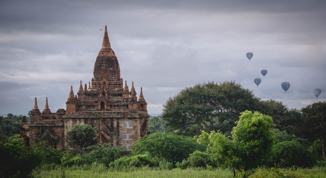 Temple in Bagan with Hot Air balloons in sky