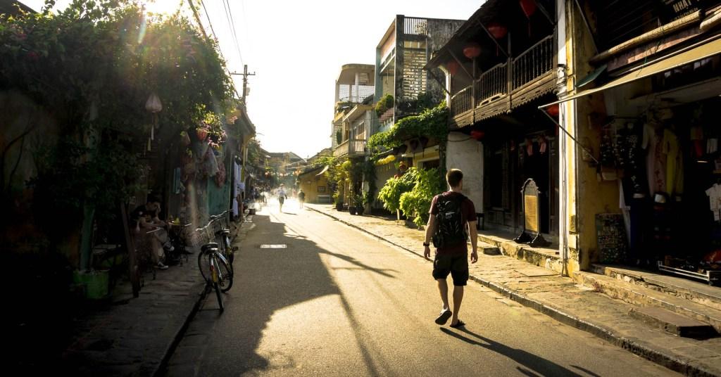 Ben walking down street in Hoi An