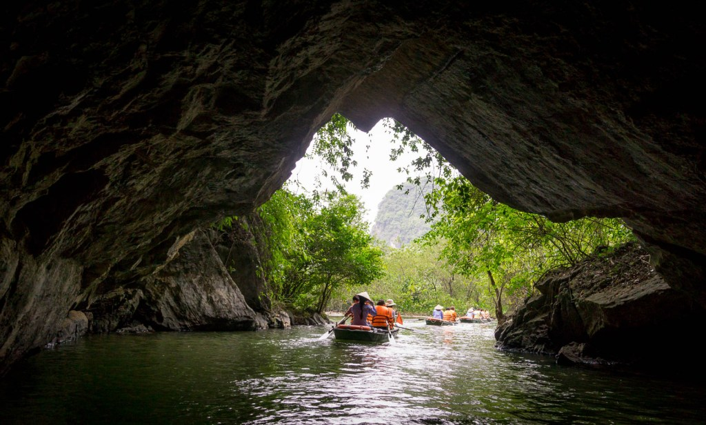 Boats leaving cave