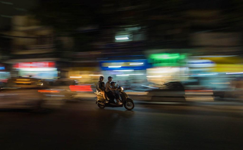 Family of four on motorbike in Hanoi