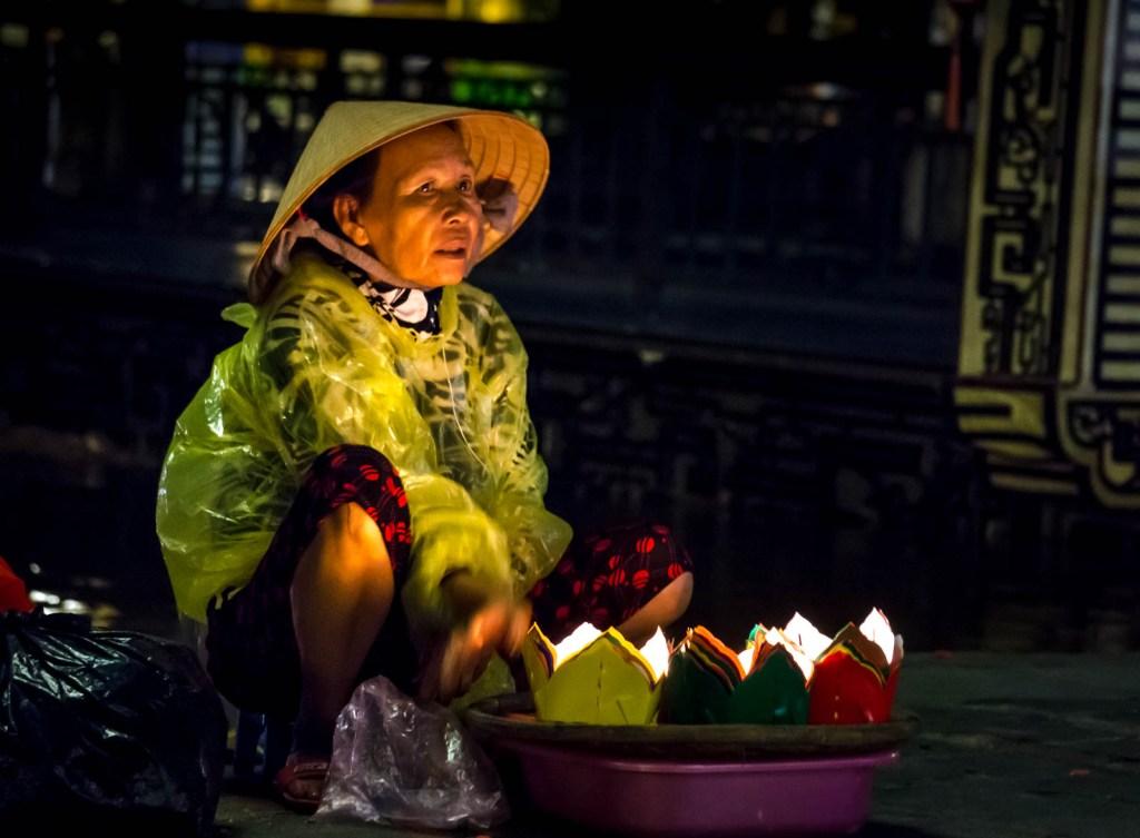 Woman selling lanterns on full moon festival