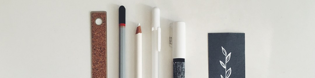 Pencils and markers on a white surface
