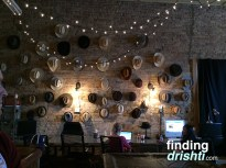 The hat wall at Proof Annex, where my meetup took place.