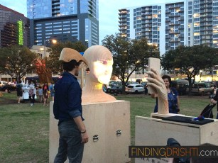 Barcelona artist, projecting faces onto a wooden 3d head