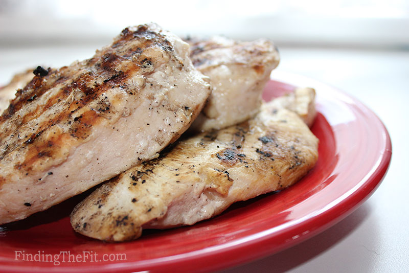 Grilled chicken on a red plate