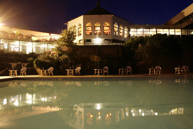 Night View of Outdoor Pool at Hoburne Torbay