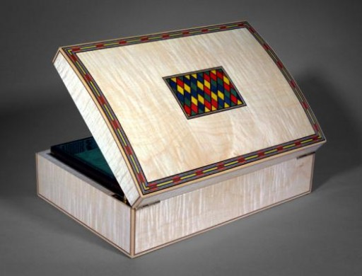 A Domed Top Jewellery Box Veneered With Figured Maple