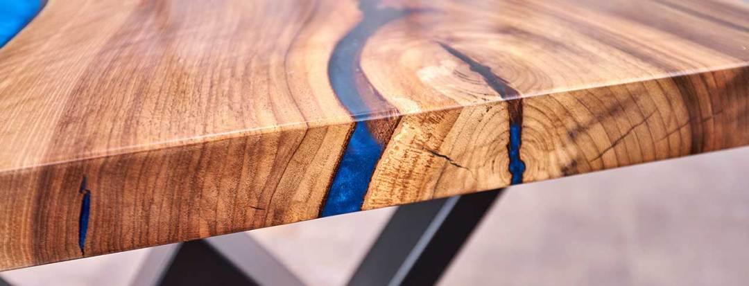 closeup custom hardwood table with blue resin