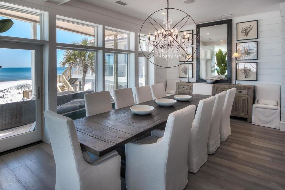 Restoration Hardware Professor Chair With Beach Style Dining Room Also Beach Front Beach View Chandelier Console Table Coral Wall Art Distressed Dining Table Large Windows Long Dining Table Mirror Natural Light Shiplap