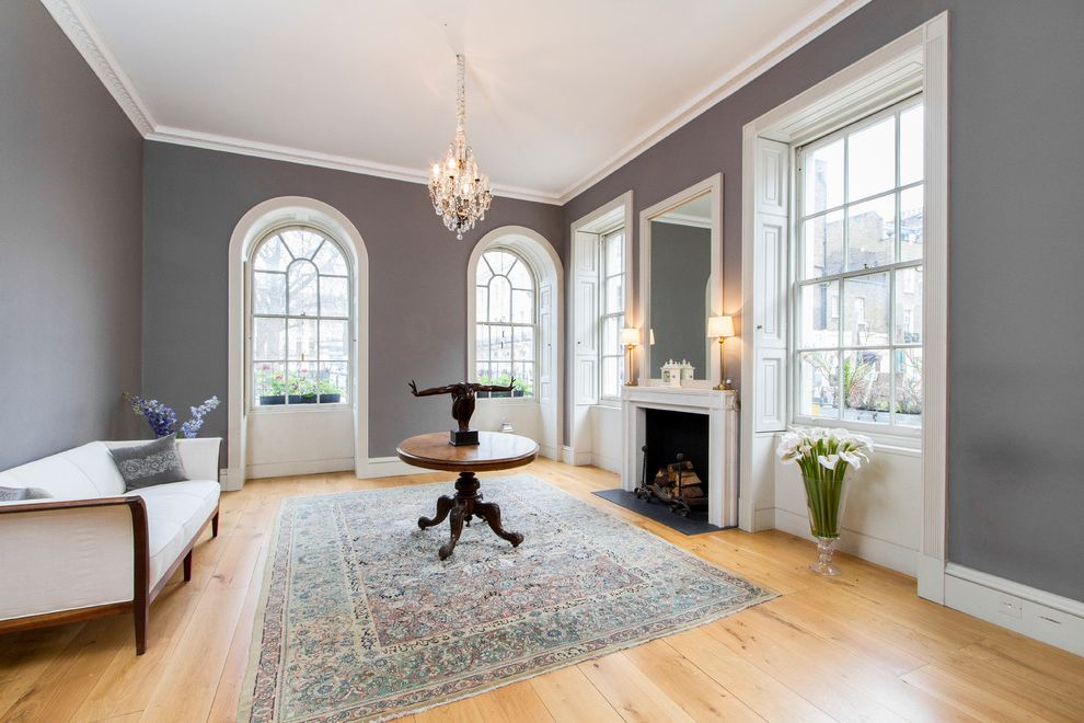 paint colors for living rooms with white trim pictures of room apartments whiskers color transitional and arched window also crystal chandelier fireplace mirror grey wall