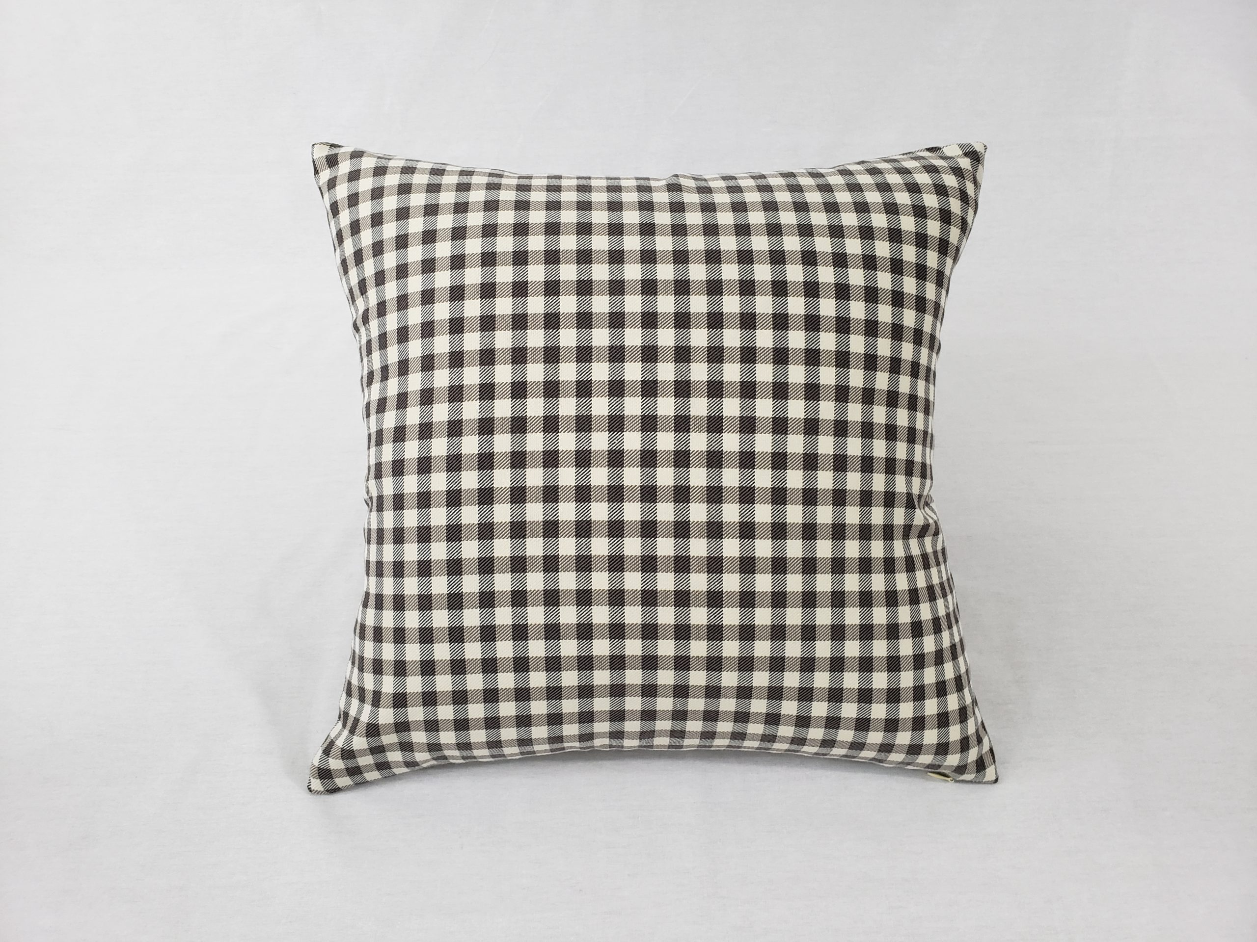 A grey and white check cushion