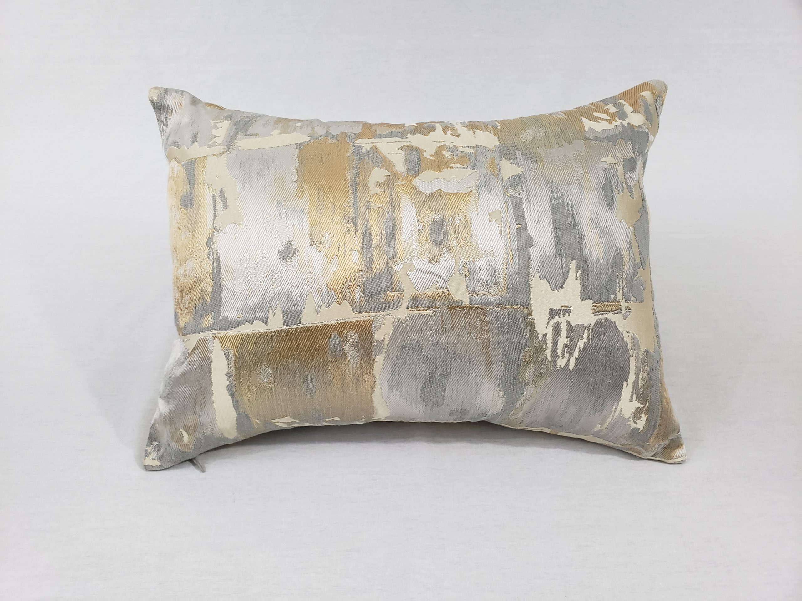 silver and gold cushion used as product image